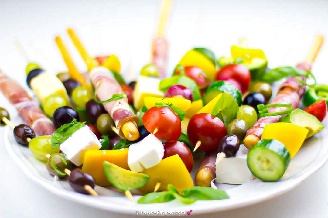 Vegetables, cheese and olives, evenly threaded onto bamboo skewers