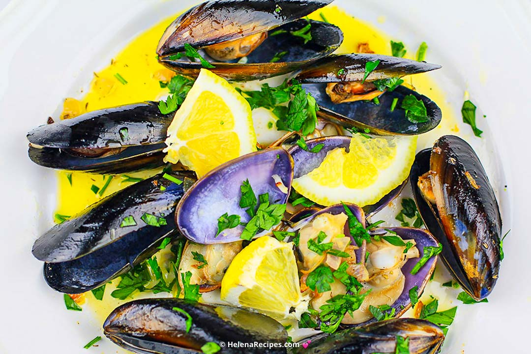 Overhead on the delicious Wine Steamed Mussels served in a big white plate
