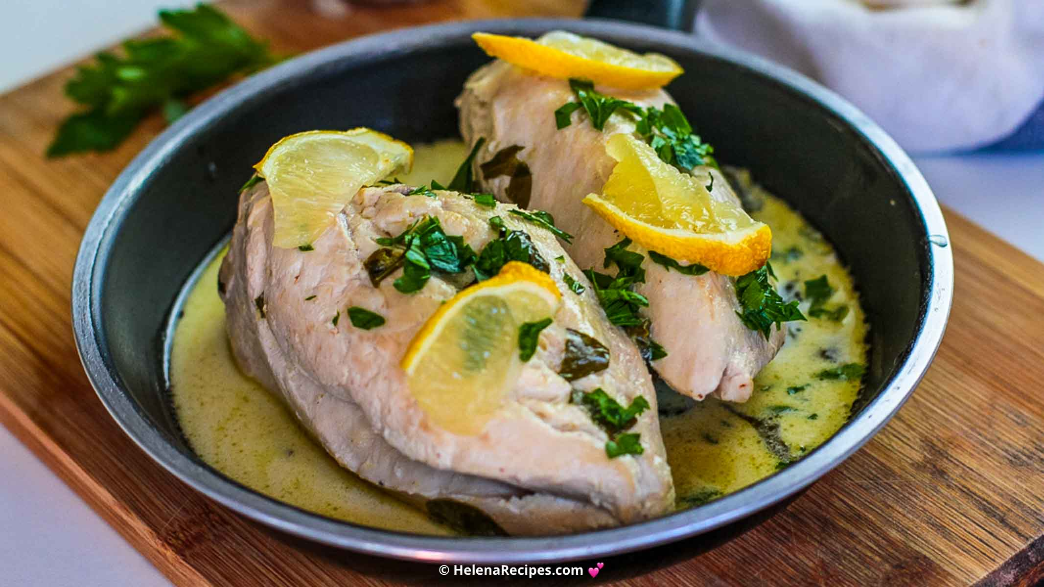 Lemon Butter Chicken Recipe served in a skillet and topped with healthy lemons