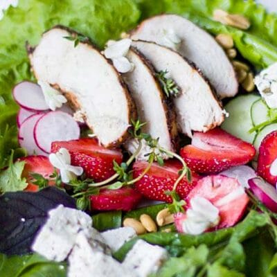 Healthy chicken feta strawberry salad decorated with some greens