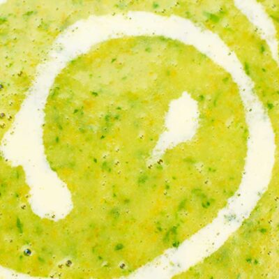 Macro shot of the Watercress Soup or Potage au Cresson served in a big white plate